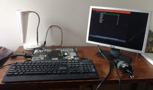 Stripped-down laptop attached to a keyboard and monitor.